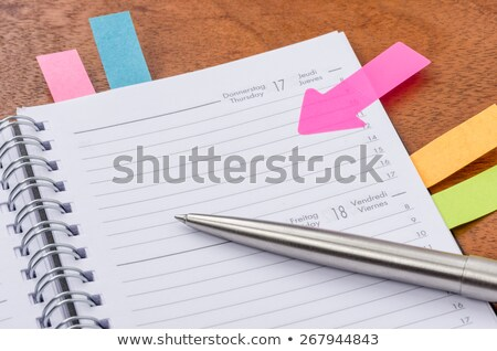 daily planner with some sticky notes stock photo © zerbor
