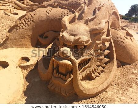 Sable statue hommes océan plage visage Photo stock © Relu1907
