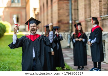 smiling female student standing outdoors stock photo © deandrobot