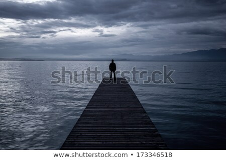 Alone Man at the Edge of Wooden Pier Stock photo © stevanovicigor