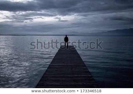 pier · homem · preto · e · branco · céu · feliz - foto stock © stevanovicigor