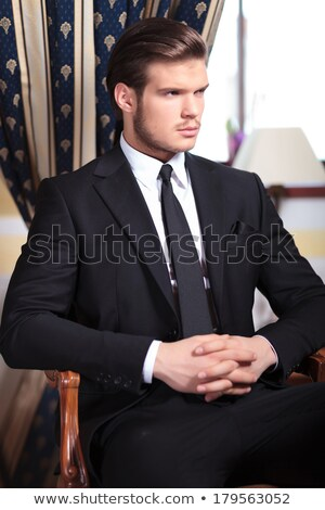 handsome young business man holding his hands together stock photo © feedough