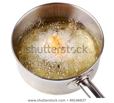 Corn flake chicken drumstick being deep fried Stock photo © Digifoodstock
