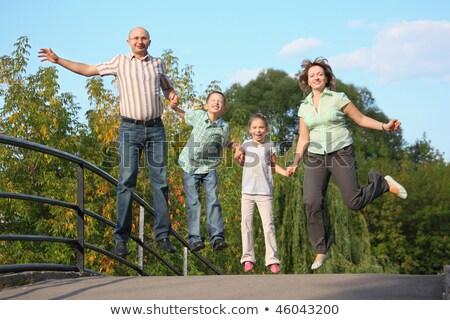 радостный семьи два детей прыжки моста Сток-фото © Paha_L