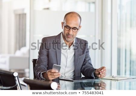 üzletember · olvas · sms · izolált · fehér · kéz - stock fotó © hasloo
