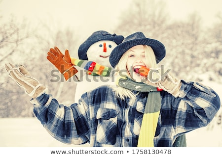 Portrait of surprised funny girl in knitted hat and mittens  Stock photo © deandrobot