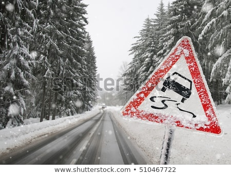 winter tires and sign slippery road stock photo © djdarkflower