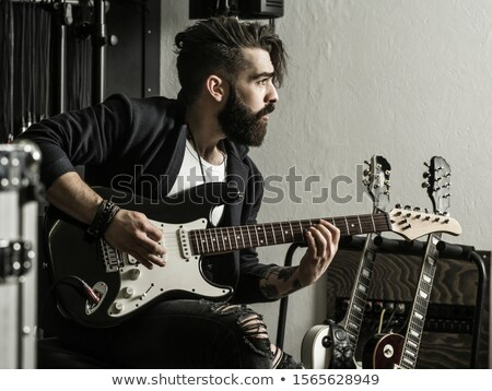 Man playing his electric guitar Stock photo © sumners