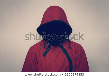spooky hooded person without face in dark room stock photo © stevanovicigor