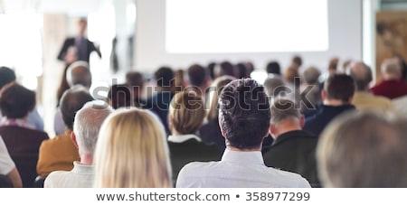 speaker giving presentation at business conference stock photo © deandrobot