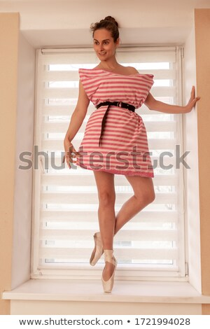 Stylish beautiful blonde drinking at the windowsill Stock photo © deandrobot