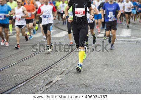 marathon runners race in city streets blurred motion stock photo © smuki