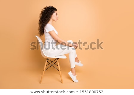 Brunette schoonheid vergadering stoel sexy Stockfoto © konradbak