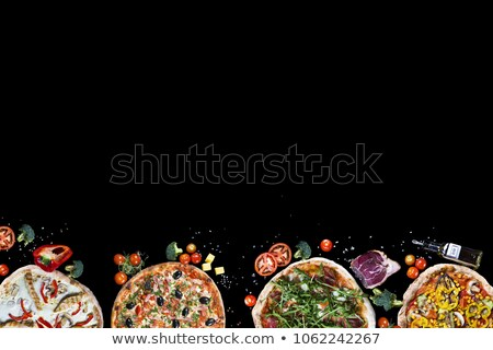 Pizza cut, cherry tomato and hot peppers Stock photo © adamr