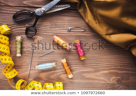 Copyspace frame with sewing tools and accesories on brown wooden Stock photo © Yatsenko
