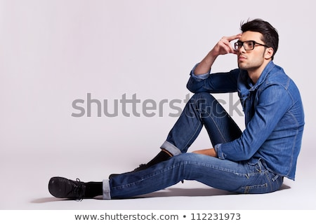 side view of a seated pensive young casual man stock photo © feedough