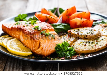 salmon fillet with roasted potatoes and fresh vegetables Stock photo © Digifoodstock