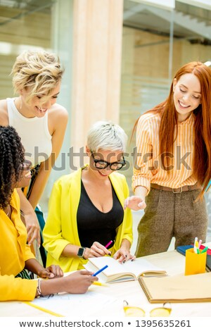 strategy meeting in creative business the group sitting at desk stock photo © kzenon