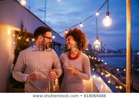 Grup arkadaş şampanya balkon ev kadın Stok fotoğraf © wavebreak_media