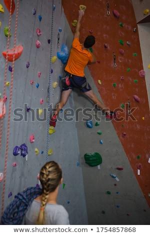 Woman practicing rope climbing in fitness studio Stock photo © wavebreak_media