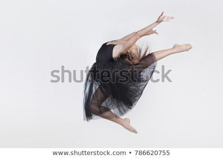 young ballet dancer wearing black transparent dress jumping stock photo © julenochek