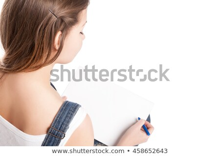 young woman drawing in her note pad back view stock photo © julenochek