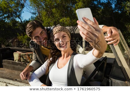 couple taking selfie in off road vehicle stock photo © wavebreak_media