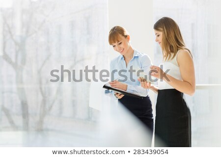 Two women looking at files Stock photo © IS2