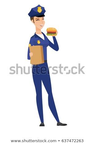 Jovem caucasiano policial alimentação hambúrguer alegre Foto stock © RAStudio