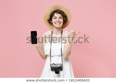 женщину · сидят · Председатель · журнала · сотовый · телефон · улыбающаяся · женщина - Сток-фото © is2