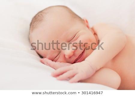 Pasgeboren glimlachend portret binnenshuis jeugd Stockfoto © IS2
