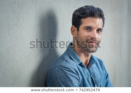 Close up portrait of a young handsome man Stock photo © deandrobot
