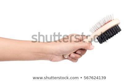 Parrucchiere mano rosolare pettine Foto d'archivio © dolgachov