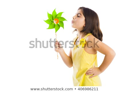girl blowing at toy windmill stock photo © is2