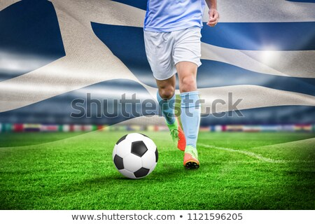 Male soccer player playing football against digitally generated greek national flag Stock photo © wavebreak_media
