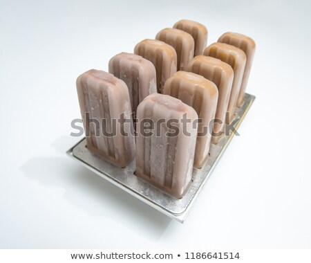 Plastic molds with coffee homemade ice cream on white background with copy space. Cold dessert Stock photo © artjazz