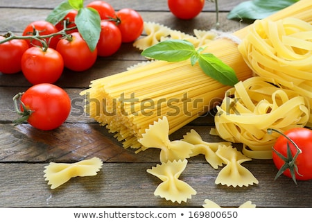 bunches of raw pasta on table stock photo © dash