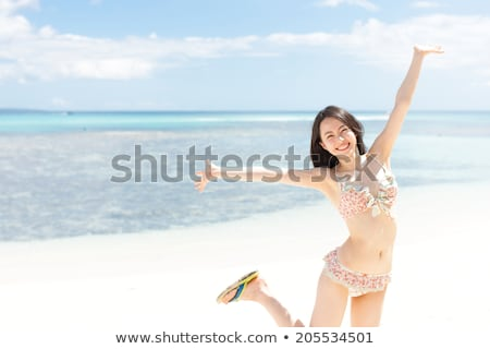 Portrait of relaxing beautiful woman in white bathing suit, and  Stock photo © deandrobot
