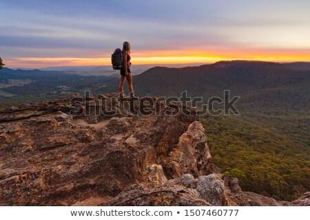 Viendo puesta de sol azul montanas sesión cielo Foto stock © lovleah