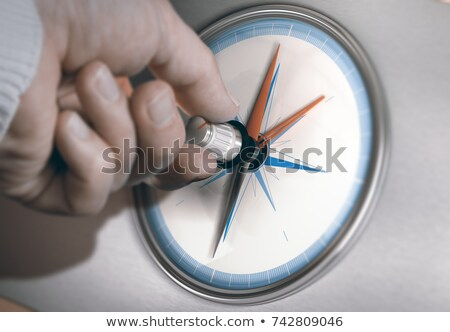 person using modern compass for professional orientation stock photo © olivier_le_moal
