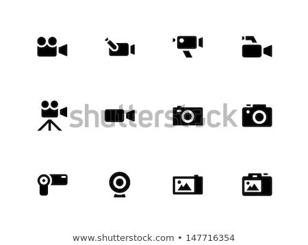 Hand digitale camera geïsoleerd witte glas professionele Stockfoto © kitch