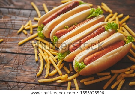 american hot dogs assorted in row served with french fries stock photo © dash