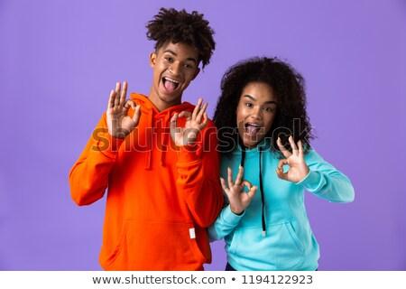 Feliz jovem bonitinho africano casal posando Foto stock © deandrobot