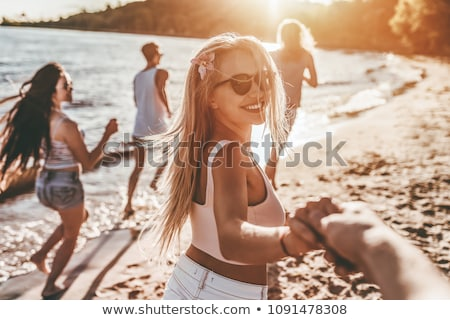 happy woman or teenage girl in sunglasses on beach stock photo © dolgachov