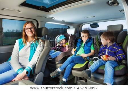 Family with three kids in a car Stock photo © Lopolo