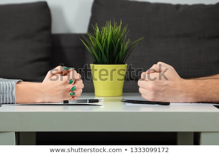 Close-up Of Husband And Wife Dividing Money Stock photo © AndreyPopov