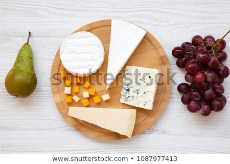 Mimolette cheese on white plate Stock photo © Alex9500