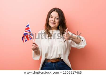Happy girl holding flag of United Kingdom Stock photo © colematt