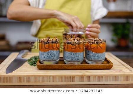 chia seed pudding with almond milk and fresh mango topping on a wooden table stock photo © galitskaya