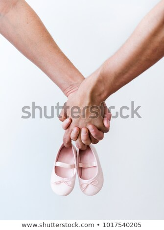 pregnant woman with hands holding baby shoe stock photo © courtyardpix